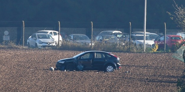 ***BELGIUM OUT***This photo taken on October 26, 2015 shows a damaged car at the army barracks in Flawinne, Namur Province, after a man attempted to drive through the barrack's barriers. According to newspaper La Derniere Heure, gun shots were heard being fired on early October 26. AFP PHOTO / BELGA / BRUNO FAHY        (Photo credit should read BRUNO FAHY/AFP/Getty Images)