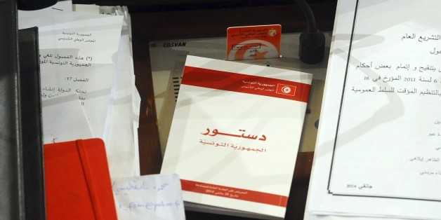 A copy of the new Tunisian Constitution lays on a parliament member's desk at the Constituent Assembly, in Tunis, Monday, Jan.27, 2014. The document is groundbreaking as one of the most progressive constitutions in the Arab world — and for the fact that it got written at all. It passed late Sunday by 200 votes out of 216 in the Muslim Mediterranean country that inspired uprisings across the region after overthrowing a dictator in 2011. (AP Photo/Hassene Dridi)