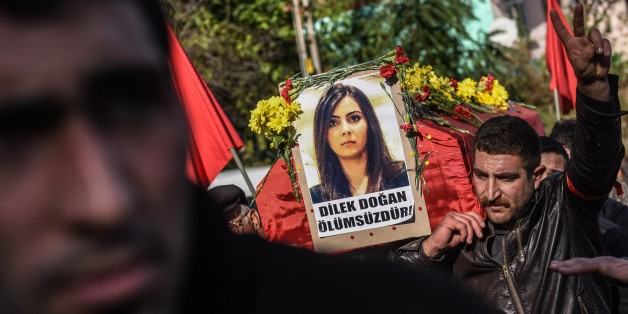 Pallbearers carry the coffin of Turkish woman Dilek Dogan during her funeral in Istanbul on October 26, 2015. Dogan, 25, died of her wounds on October 25 after being shot at home in Istanbul's Sariyer district during a police raid on October 18 as part of an operation into the Revolutionary People's Liberation Party/Front (DHKP/C). The circumstances of her death remain unclear. AFP PHOTO / OZAN KOSE        (Photo credit should read OZAN KOSE/AFP/Getty Images)