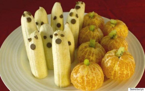 having spooky fruit dressed as ghosts and pumpkins is a great way to keep snacks healthy yet fun to eat