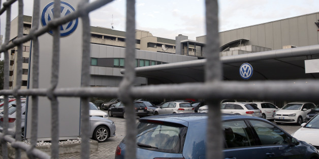 Cars are parked at a Volkswagen dealer in Milan, Italy, Thursday, Oct. 15, 2015. Italian authorities have searched the headquarters of Volkswagen Italia as part of a local investigation into the emissions testing scandal at the German automaker. The financial police in the northern city of Verona conducted the searches on Thursday and confirmed that there are officials under investigation. (AP Photo/Luca Bruno)