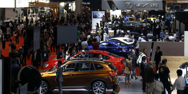 Vehicles produced by Bayerische Motoren Werke AG (BMW), front, and Toyota Motor Corp.'s Lexus unit, rear, stand on display at the Tokyo Motor Show in Tokyo, Japan, on Wednesday, Oct. 28, 2015. Toyota Motor Corp., Honda Motor Co. and Nissan Motor Co. are among automakers displaying new fuel-cell and electric vehicles at this year's Tokyo Motor Show, which runs through Nov. 8. Photographer: Tomohiro Ohsumi/Bloomberg via Getty Images