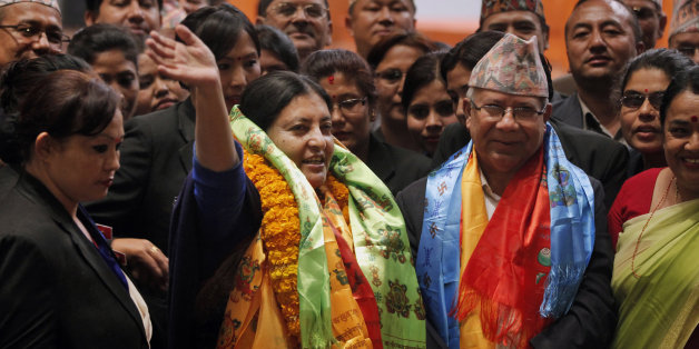 Bidhya Devi Bhandari of the Communist Party of Nepal Unified Marxist-Leninist waves her hand after she was elected as Nepal's new president in Kathmandu, Nepal, Wednesday, Oct. 28, 2015. Bhandari, 54, who has long campaigned for women's rights was elected Wednesday as Nepal's first female president. (AP Photo/Niranjan Shrestha)