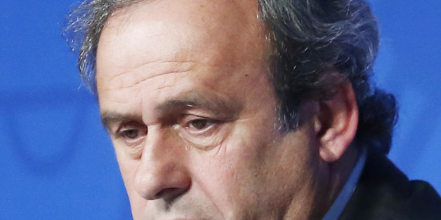 FILE - In this June 10, 2015 file photo UEFA President Michel Platini attends a press conference to mark the one year to go before the start of EURO 2016 soccer tournament in Paris. On Friday, Oct. 9, 2015 file photo FIFA provisionally banned UEFA President Michel Platini for 90 days. (AP Photo/Jacques Brinon)