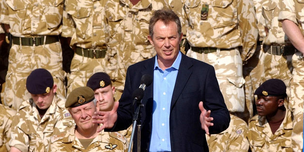 File photo dated 04/01/04 of Tony Blair addressing British troops on a visit to Basra, Iraq. Saddam Hussein would have acted like Syrian leader Bashar Assad and brutally turned on his own people if the US-led coalition had not removed him from power, Mr Blair has claimed.