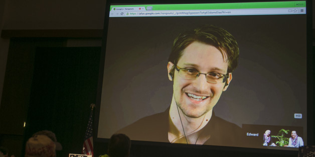 National Security Agency leaker Edward Snowden appears on a live video feed broadcast from Moscow at an event sponsored by the ACLU Hawaii in Honolulu on Saturday, Feb. 14, 2015. (AP Photo/Marco Garcia)