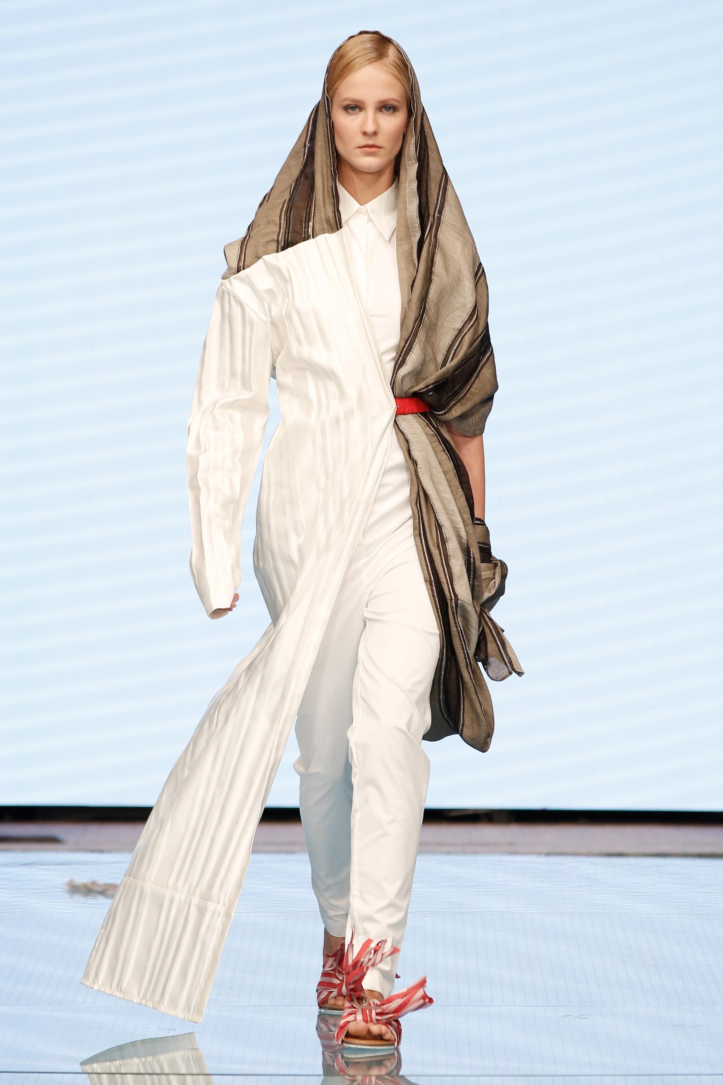 a model walks the runway at the reem al kanhal sho