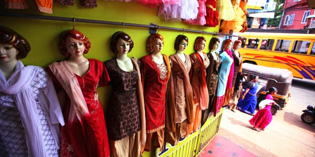 TRIVANDRUM, INDIA - DECEMBER 22:  Shop dummies show the new collection of typical indian salwar kalmeez and saree fashion for ladies and children in Varkala  on December 22, 2009 in Varkala near Trivandrum, Kerala, India. (Photo by EyesWideOpen/Getty Images)