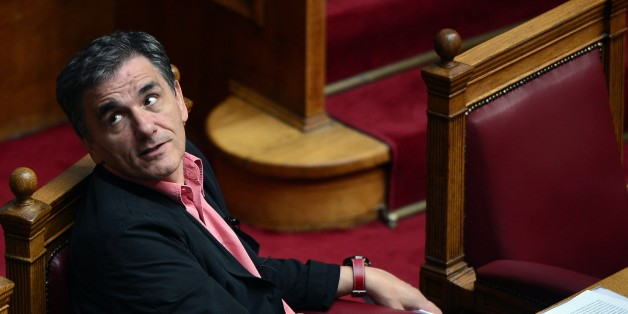 Greek  Finance Minister Euclid Tsakalotos attends a debate at the Greek parliament in Athens on October 16, 2015, before voting on a new bill with additional tax hikes and reforms stemming from the country's third EU bailout, a condition for the release of bailout funds. Greece's parliament was expected to approve later today a first batch of reforms and tax cuts stemming from its third EU bailout.  AFP PHOTO/ LOUISA GOULIAMAKI        (Photo credit should read LOUISA GOULIAMAKI/AFP/Getty Images)