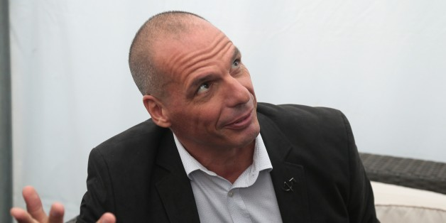 Former Greek Finance Minister Yannis Varoufakis meets with French Communist Party's secretary general at the Fete de l'Humanite 2015 (Humanity Festival) in La Courneuve, near Paris, on September 12, 2015.  AFP PHOTO/JACQUES DEMARTHON        (Photo credit should read JACQUES DEMARTHON/AFP/Getty Images)
