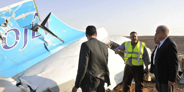 In this image released by the Prime Minister's office, Sherif Ismail, right, looks at the remains of a crashed passenger jet in Hassana Egypt, Friday, Oct. 31, 2015. A Russian aircraft carrying 224 people, including 17 children, crashed Saturday in a remote mountainous region in the Sinai Peninsula about 20 minutes after taking off from a Red Sea resort popular with Russian tourists, the Egyptian government said. There were no survivors.(Suliman el-Oteify, Egypt Prime Minister's Office via AP)