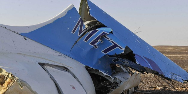 Image released by the Prime Minister's office shows the tail of a Metrojet plane that crashed in Hassana, Egypt