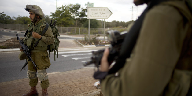 Israeli soldiers secure a checkpoint near the West Bank town of Nablus, Friday, Oct. 30, 2015. Two Palestinians carrying knives ran toward another checkpoint nearby, drawing fire from troops who killed one and critically wounded the other, according to police and a Palestinian medic. (AP Photo/Ariel Schalit)