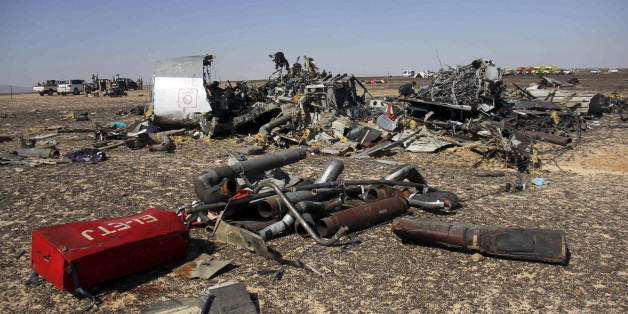 Egyptian security forces stand guard by debris of a Russian airplane at the site a day after the passenger jet bound for St. Petersburg, Russia crashed in Hassana, Egypt, on Sunday, Nov. 1, 2015. The Metrojet plane, bound for St. Petersburg in Russia, crashed 23 minutes after it took off from Egypt's Red Sea resort of Sharm el-Sheikh on Saturday morning. The 224 people on board, all Russian except for four Ukrainians and one Belarusian, died. (AP Photo)