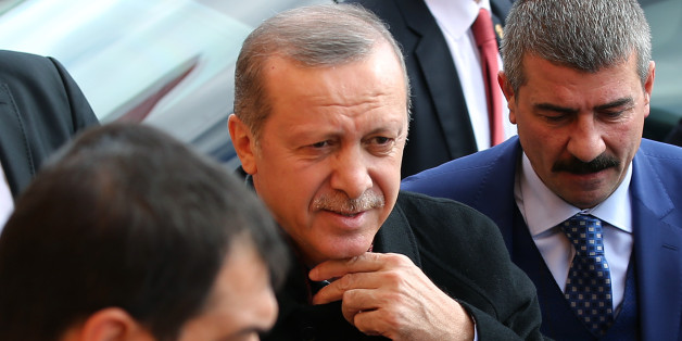 Turkey's President Recep Tayyip Erdogan, center, escorted by his bodyguards heading to his car outside a polling station, in Istanbul, Sunday, Nov. 1, 2015. Turkey holds a parliamentary election Sunday, a redo of the June election in which the Justice and Development Party, or AKP, lost its majority after 13 years of single-party rule. The key question is whether the ruling party gets enough seats for an outright majority in parliament or whether they have to form a coalition with one or more other parties in order to govern. (AP Photo/Hussein Malla)