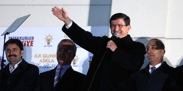 Turkish Prime Minister Ahmet Davutoglu addresses supporters from the balcony of the Justice and Development Party (AKP) headquarters in Ankara on November 1, 2015. Turkey's long-dominant Justice and Development Party (AKP) scored a stunning electoral comeback, regaining its parliamentary majority in a poll seen as pivotal for the future of the troubled country. AFP PHOTO / ADEM ALTAN        (Photo credit should read ADEM ALTAN/AFP/Getty Images)