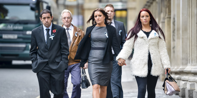 Friends and family of Becky Watts, including her grandfather, John Galsworthy (second left), wear blue ribbons in support of Becky Watts as they arrive at Bristol Crown Court on the first day of Nathan Matthews defence case in the murder trial.