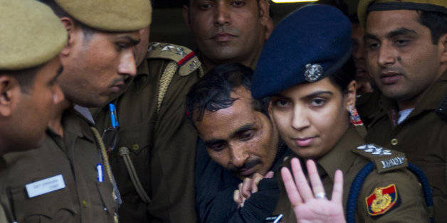 FILE – In this Monday, Dec. 8, 2014 file photo, 32-year-old Shiv Kumar Yadav, center, a driver from the international taxi-booking service Uber, is escorted by police to be produced to a court in New Delhi, India. A New Delhi court on Tuesday, Jan. 13, 2015, charged the Uber cab driver with the rape, kidnapping and criminal intimidation of a 25-year-old woman who hired the taxi service for a ride home from a dinner engagement last month. (AP Photo/Saurabh Das, File)