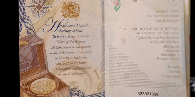 The opening pages from the new British passport design that have been unveiled at Shakespeare's Globe Theatre in London.