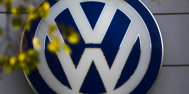 FILE - This Oct. 5, 2015 file photo shows the Volkswagen logo at the building of a company retailer in Berlin, Germany. Volkswagen almost inevitably will have to compensate owners of diesel cars equipped with emissions-rigging software. Some legal experts say the automaker could be forced to buy back the cars altogether. (AP Photo/Markus Schreiber, File)
