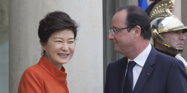 France's President Francois Hollande, right, poses for photographers with South Korean President Park Geun Hye at the Elysee Palace in Paris, Monday, Nov. 4, 2013. Park arrived in France as part of her weeklong trip to Western Europe including Britain and Belgium. This is the first time Park has been to France in 39 years, when she returned after six months of studying upon the assassination of her mother, first lady Yook Young-soo, in 1974. (AP Photo/Michel Euler)