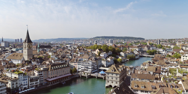 Old Town Zurich view of city with St. Peter's Church clock tower and the Limmat River