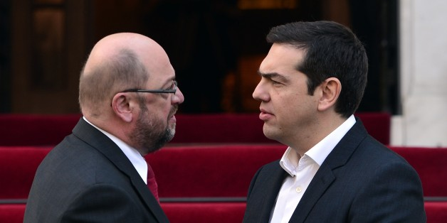Greek prime minister Alexis Tsipras (R) greets European Parliament President Martin Schulz prior to their talks in Athens on November 4, 2015. The first refugees were leaving Greece on November 4 under a relocation plan to ease pressure on countries bearing the brunt of Europe's migrant crisis, with 30 Syrians and Iraqis heading to start new lives in Luxembourg. AFP PHOTO/LOUISA GOULIAMAKI        (Photo credit should read LOUISA GOULIAMAKI/AFP/Getty Images)