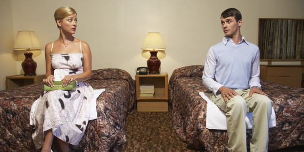 Nervous Couple in Motel Room