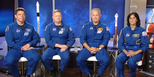 In this image made from video provided by NASA, astronauts, from left, Bob Behnken, Eric Boe, Doug Hurley and Suni Williams gather for an interview at the Johnson Space Center in Houston on Friday, July 10, 2015. On Wednesday, NASA announced the four were chosen to fly on the first test flights of commercial spacecraft. (NASA via AP)