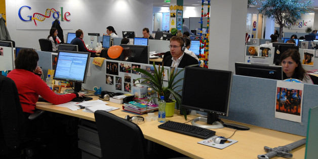 """Employees work in one of the open space work areas in the offices of Google, at their European headquarters in Dublin, Monday, April 10, 2006. Dublin's new Docklands,  where scores of cranes feed the frenzy for new hotels and gleaming office blocks, offer a vibrant microcosm of Ireland's rise from Europe's emigration blackspot to its """"brain gain"""" capital. Poles, Iranians, Swedes, Chinese, Nigerians are among the throngs performing tasks ranging from hawking fast food to writing software code. In"""