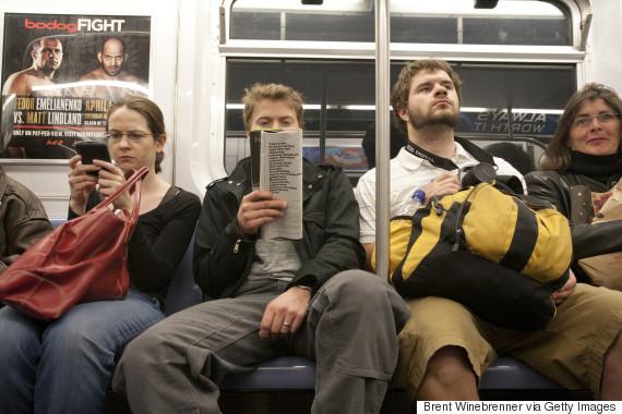 man sitting on train