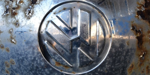 The logo of German car maker Volkswagen (VW) is seen on the wheel cap of a vintage VW beetle car at a workshop in Usseln, western Germany, on November 4, 2015. Shares in Volkswagen took a renewed battering as evidence emerged that the massive pollution cheating scandal engulfing the company may also involve petrol engines, not just diesel engines.     AFP PHOTO / DPA / UWE ZUCCHI   +++   GERMANY OUT   +++        (Photo credit should read UWE ZUCCHI/AFP/Getty Images)