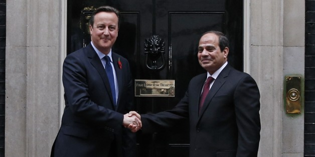 British Prime Minister David Cameron (L) shakes hands with Egyptian President Abdel Fattah al-Sisi (R) as he welcomes him to 10 Downing Street in central London on November 5, 2015. Sisi held talks with Cameron on November 5 on security and the Sinai plane crash, as concerns mount it could have been caused by a bomb.  AFP PHOTO / ADRIAN DENNIS        (Photo credit should read ADRIAN DENNIS/AFP/Getty Images)