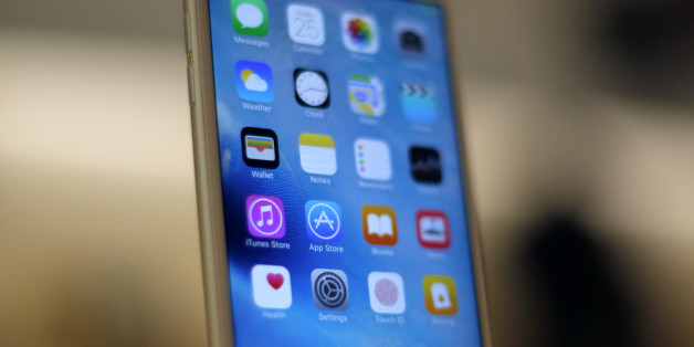 A new Apple iPhone 6S is displayed at an Apple store on Chicago's Magnificent Mile, Friday, Sept. 25, 2015, in Chicago. (AP Photo/Kiichiro Sato)