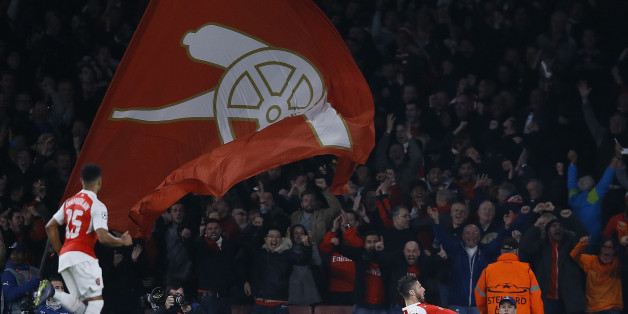 Arsenal's Olivier Giroud, right, celebrates after scoring during the Champions League Group F soccer match between Arsenal and Bayern Munich at Emirates stadium in London Tuesday, Oct. 20, 2015. (AP Photo/Kirsty Wigglesworth)