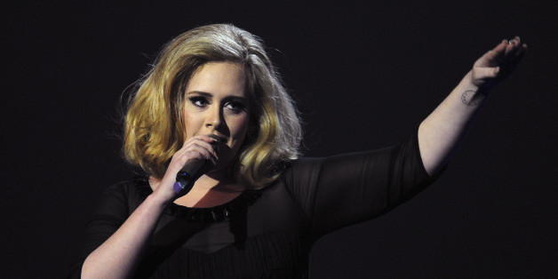 British singer-songwriter Adele accepts the British Female Solo Artist award at the BRIT Awards 2012 in London on February 21, 2012.   AFP PHOTO / LEON NEAL (Photo credit should read LEON NEAL/AFP/Getty Images)
