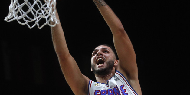 France's Evan Fournier dunks a basket during the EuroBasket European Basketball Championships match, round of sixteen, between France against Turkey, on Saturday, Sept. 12, 2015 in Lille, northern France. (AP Photo/Michel Spingler)