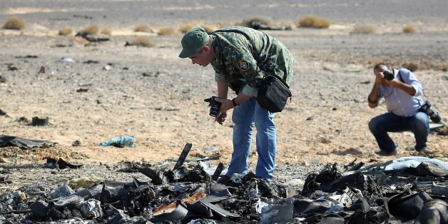Egyptian officials inspect the crash site of Russian Airliner in Suez, Egypt on November 01, 2015. A Russian Airbus-321 airliner with 224 people aboard crashed in Egypt's Sinai Peninsula on yesterday. According to Egypts Civil Aviation Authority, the plane had been lost contact with air-traffic controllers shortly after taking off from the Egyptian Red Sea resort city of Sharm el-Sheikh en route to St Petersburg. (Photo by Alaa El Kassas/Anadolu Agency/Getty Images)