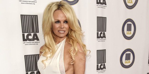 """Pamela Anderson, recipient of the """"Vegan of the Year"""" award, poses at the 2015 Last Chance for Animals Annual Benefit at the Beverly Hilton on Saturday, Oct. 24, 2015, in Beverly Hills, Calif. (Photo by Chris Pizzello/Invision/AP)"""