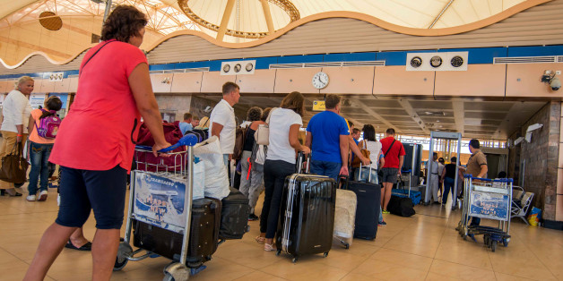 Passengers line up to depart from Sharm el-Sheikh Airport hours after a Russian aircraft carrying 224 people, including 17 children, crashed about 20 minutes after taking off from Sharm el-Sheikh, a Red Sea resort popular with Russian tourists, in south Sinai, Egypt, Saturday, Oct. 31, 2015. A Russian Metrojet plane crashed Saturday morning in a mountainous region in the Sinai after taking off from Sharm el-Sheikh, killing all 224 people aboard. A senior aviation official said the pilot had radi