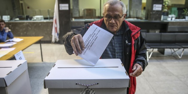 ZAGREB, CROATIA - NOVEMBER 08: A Croatian man casts his ballot for the parliamentary elections at a polling station in Zagreb, Croatia on November 08, 2015. (Photo by Kemal Zorlak/Anadolu Agency/Getty Images)