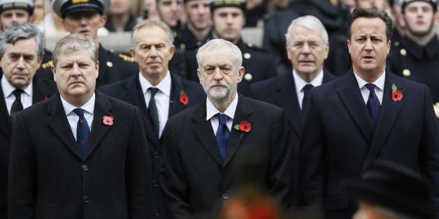 Britain's Prime Minister David Cameron, right, and Leader of the opposition Labour Party Jeremy Corbyn, centre, with SNP representative Angus Robertson, left, attend the Remembrance Sunday ceremony at the Cenotaph in London, Sunday, Nov. 8, 2015, with Britain's Queen Elizabeth II, extreme foreground right. Remembrance Sunday is held each year to commemorate the service men and women who fought in past military conflicts. (AP Photo/Kirsty Wigglesworth)
