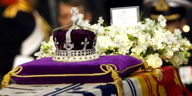 """The Koh-i-noor, or """"mountain of light,"""" diamond, set in the Maltese Cross at the front of the crown made for Britain's late Queen Mother Elizabeth, is seen on her coffin, along with her personal standard, a wreath and a note from her daughter, Queen Elizabeth II, as it is drawn to London's Westminster Hall in this April 5, 2002 file photo. We've got it, we're keeping it. That was the essence of the British government's attitude in responding to Pakistan's request for the return of the fabled Koh"""