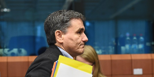 Greece's Finance Minister Euclid Tsakalotos arrives for an Eurogroup Finance Ministers' meeting at the European Council, in Brussels on November 9, 2015. AFP PHOTO/Emmanuel Dunand        (Photo credit should read EMMANUEL DUNAND/AFP/Getty Images)