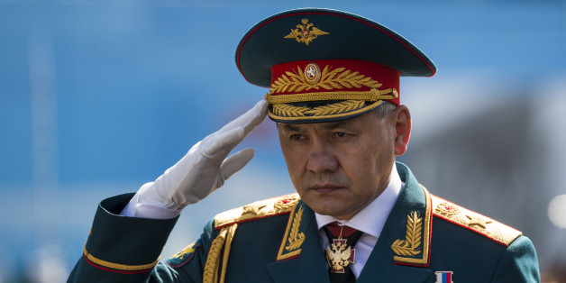 Russian Defence Minister Sergei Shoigu salutes to his soldiers as he is driven along the Red Square, during the Victory Parade marking the 70th anniversary of the defeat of the Nazi Germany in World War II, in Moscow, Russia, Saturday, May 9, 2015. (AP Photo/Alexander Zemlianichenko, pool)