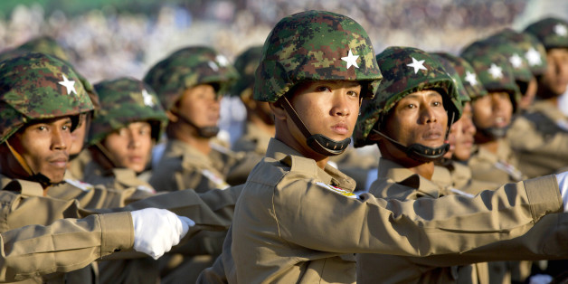 In this Jan. 4, 2015, file photo, Burmese military officers march in a parade during a ceremony for Myanmar's 67th anniversary of Independence Day in Naypyitaw, Myanmar. Campaigning kicked off Tuesday, Sept. 8, 2015, for Myanmar's Nov. 8 general election, which is expected to be the Southeast Asian country's most credible vote in more than a half-century. Still, the military retain a powerful role despite having made way for a civilian government in 2010, and political and economic ref