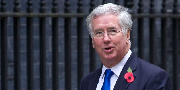 British Defence Secretary Michael Fallon arrives for the weekly cabinet meeting at 10 Downing Street in London on October 27, 2015. Britain will keep its current level of 450 troops on non-combat missions in Afghanistan into 2016, Defence Secretary Michael Fallon said in a written statement to parliament on October 27. AFP PHOTO / JUSTIN TALLIS        (Photo credit should read JUSTIN TALLIS/AFP/Getty Images)