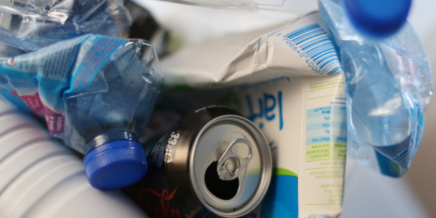 Water and milk bottles and cans are seen in a selectif sorting trash bin before been recycling, in Paris on March 18, 2013.  AFP PHOTO THOMAS SAMSON        (Photo credit should read THOMAS SAMSON/AFP/Getty Images)