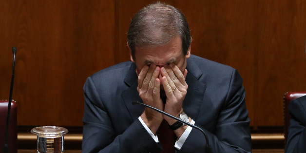 Portuguese Prime Minister Pedro Passos Coelho rubs his eyes during the debate of the government's four-year policy program at the Parliament in Lisbon, Tuesday, Nov. 10 2015. Together the left-of-center parties have 122 seats in the 230-seat Parliament, outnumbering the government, and have vowed to reject the program in a vote. Such a defeat would force the government, which took office on Oct. 30, to resign, possibly opening the door for the unprecedented leftist alliance to take over. (AP Pho