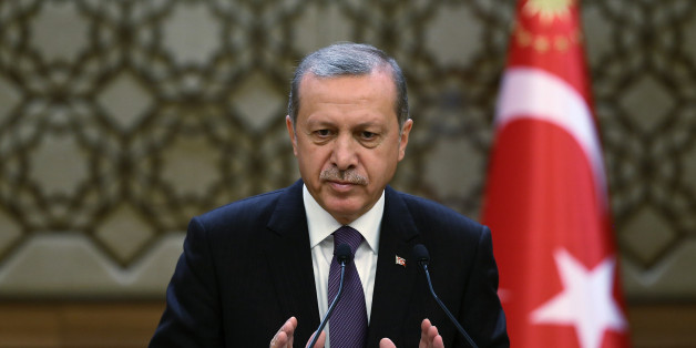 Turkish President Recep Tayyip Erdogan addresses a meeting of local administrators at his palace in Ankara, Turkey, Wednesday, Nov. 4, 2015. Turkey could hold a referendum on constitutional changes for a new political system, reviving a highly contentious push to increase the powers of the president, an aide to Erdogan said Wednesday. The ruling Justice and Development Party, or AKP, which Erdogan founded and continues to lead from behind the scenes, scored a stunning victory in a parliamentary election Sunday, gaining back the majority it lost in a previous election just five months ago. (AP Photo/Kayhan Ozer, Presidential Press Service, Pool)